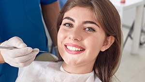 Happy woman relaxed in dental chair