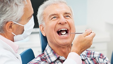 Senior man receiving dental exam