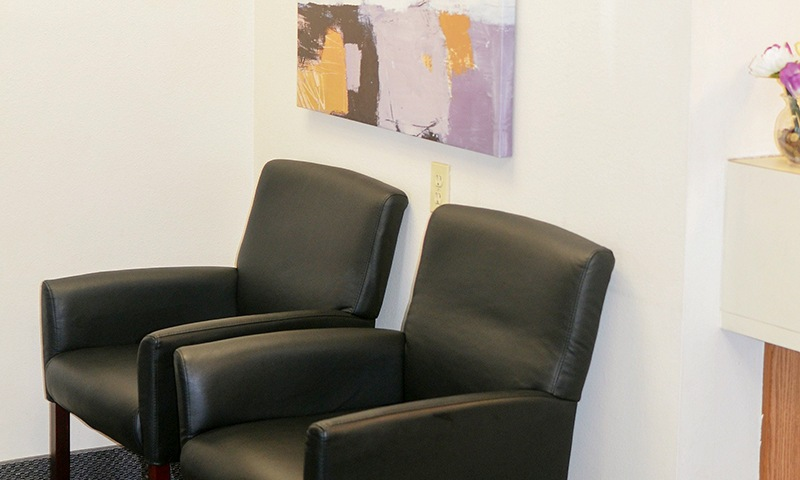 Comfortable seating in dental waiting area
