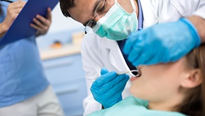 Dentist providing root canal therapy