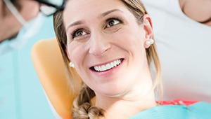 Relaxed woman smiling in dental chair
