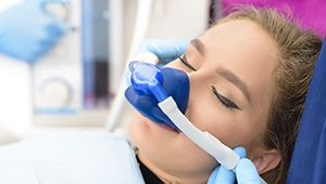 Relaxed woman with nitrous oxide nose mask