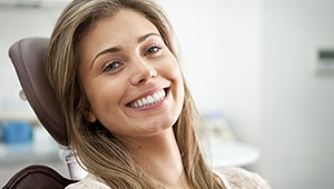 Happy relaxed woman in dental chair