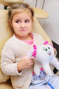 unhappy girl at dentist