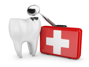 A tooth next to a first-aid kit
