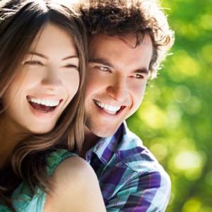 a couple with beautiful smiles thanks to the dentist sun city resident prefer Smile Fitness Dental Centers