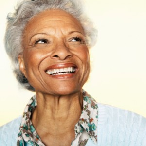 senior woman smiling with dentures from Smile Fitness Dental Center
