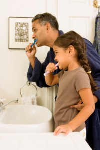 Father and daughter great tooth brushing skills from Smile Fitness Dental Center