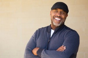 Man with a beautiful smile thanks to dental implants in glendale, AZ